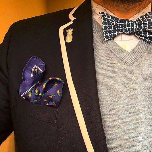 patterned bow tie with a gray sweater